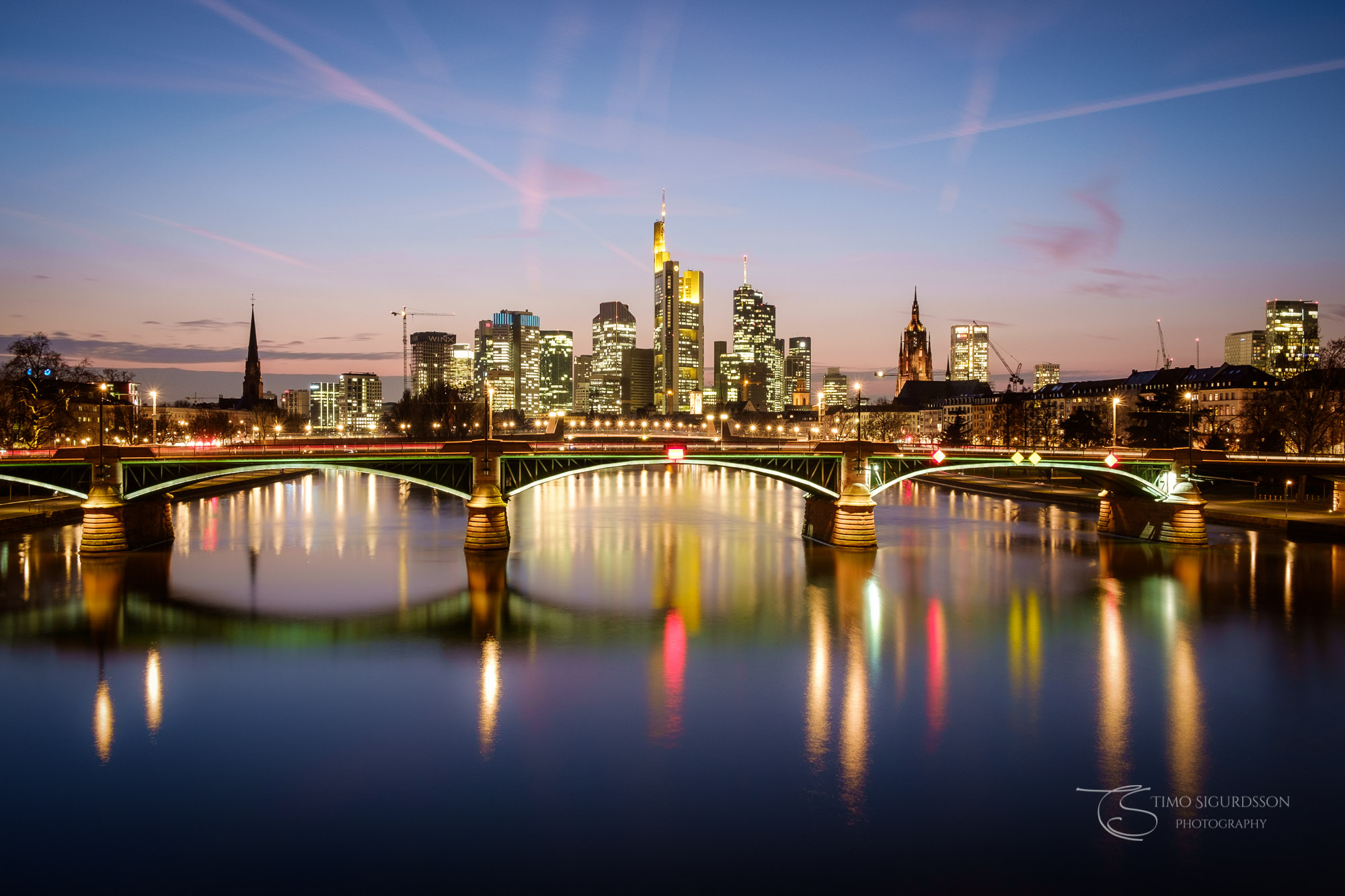 Frankfurt, Germany. Skyline at dusk. Ignatz Bubis bridge and river Main.
