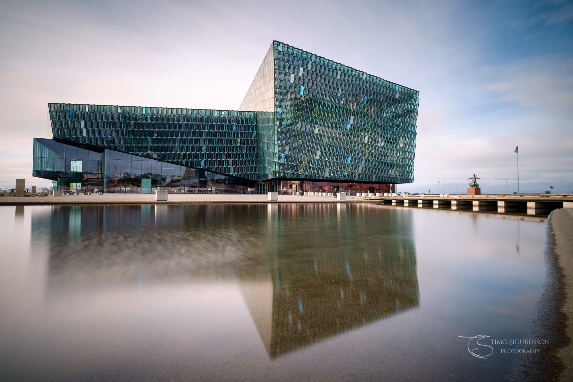 Harpa Concert Hall, Reykjavik, Icaland. Reflection in pond.