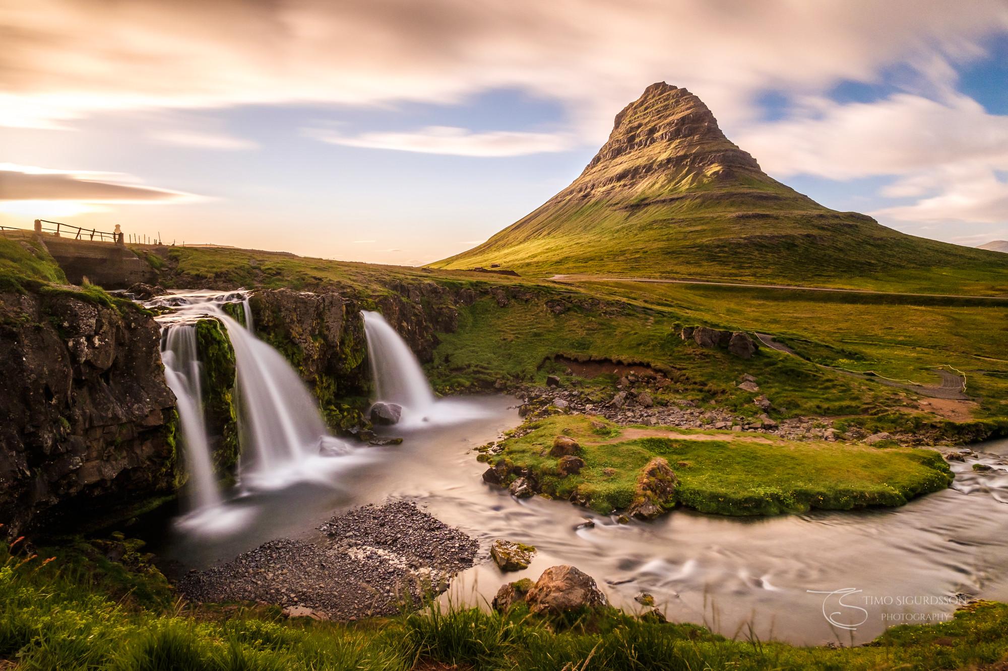 Grundarfjörður, Iceland. Kirkjufell mountain behind Kirkjufellsfoss waterfalls at dusk.