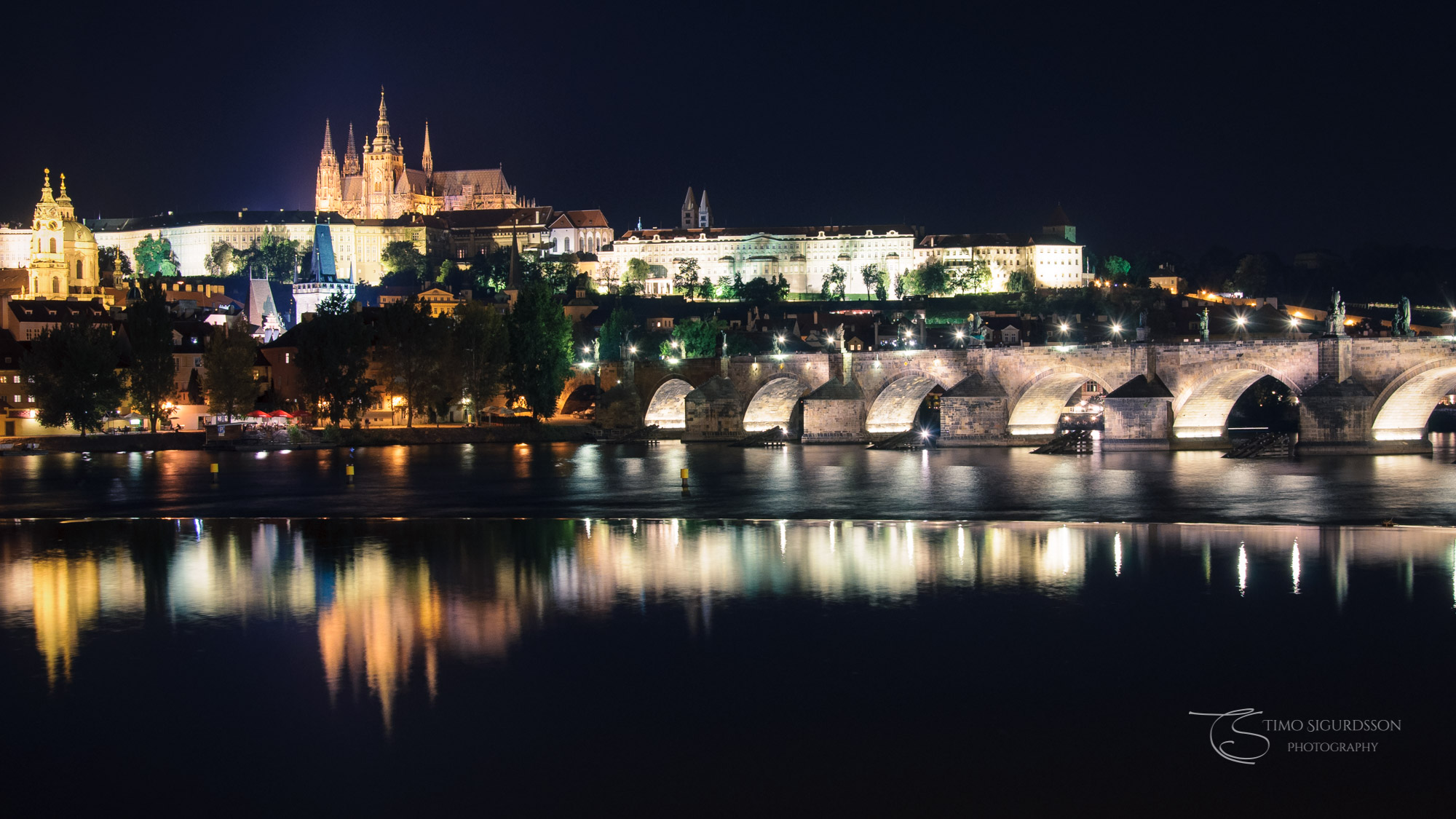 Prague | Praha, Czechia. Castle and Charles Bridge at night. River Vltava.