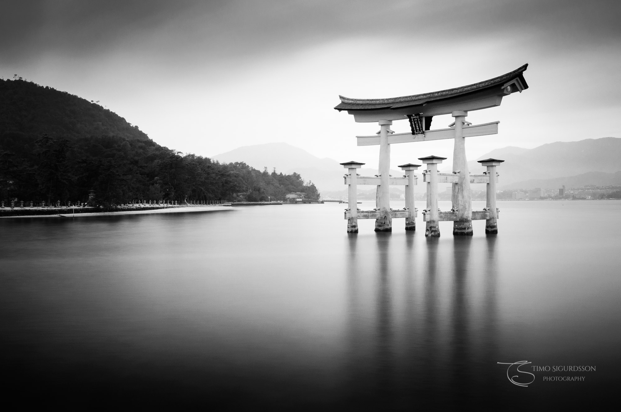 Itsukushima Shrine, Miyajima, Japan. Torii gate floating on the water.
