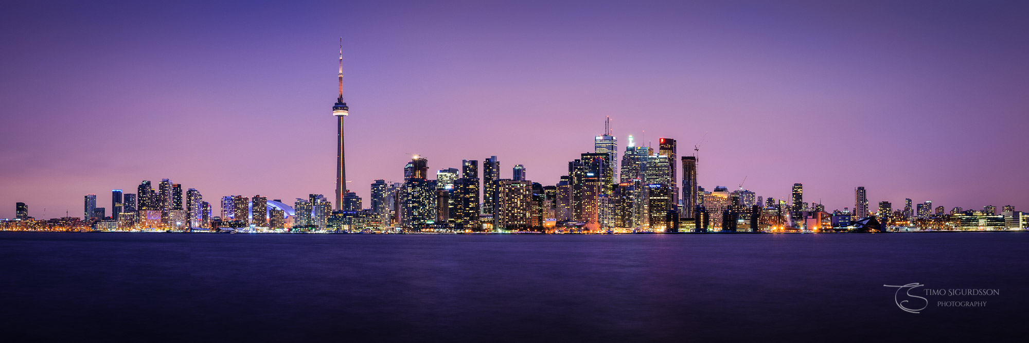 Toronto, Canada. Skyline panorama at night. Lake Ontario. Ward's Island.