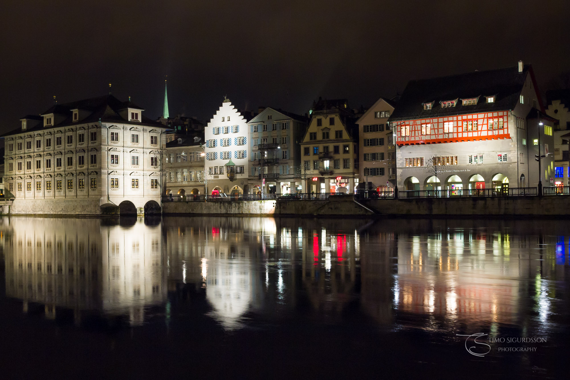 Limmat riverside, Zurich, Switzerland. Reflections at night.